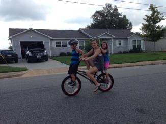 AJ gives the kids a ride on Gavin's new 20'' BMX bike